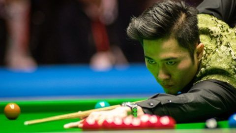 Cao Yupeng of China plays a shot to Neil Robertson of Australia in their final match during the 2017 Dafabet Scottish Open snooker tournament in Glasgow, UK, 17 December 2017.  Neil Robertson defeated Cao Yupeng 9-8.
