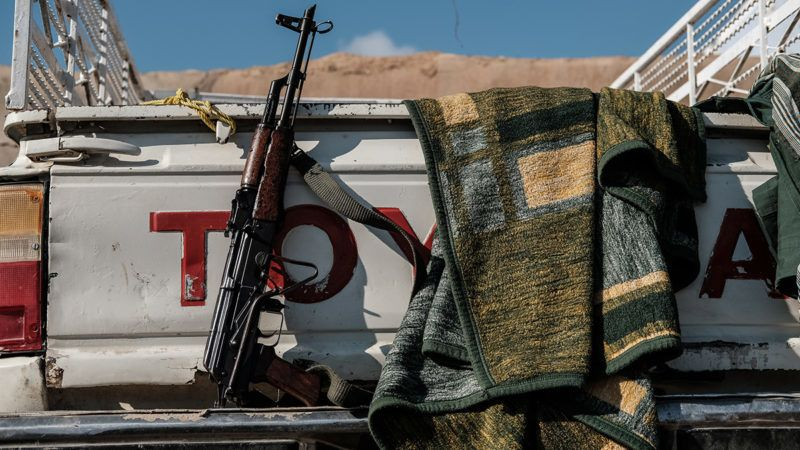 """January 2017, Wardak, Iraq. Peshmerga Kalashnikov rifle at Toyota car. The Kaka'i Kurds are returning to their homes as Mosul offensive continiues. The Kaka'i Kurds are one of several multi-ethnic groups who are part of the Yarsan or Ahl el-Haqq (people of truth), a religion founded by Sultan Sahak in the late 14th century in western Iran. Some Yarsanis in Iraq are called the Kaka'is. The Kakais are one of the religious minorities scattered throughout northern Iraq in the provinces of Sulaimaniyah and Halabja, in the Ninevah Plains of Ninevah province and in villages to the southeast of Kirkuk. Historians and researchers disagree on their classification, as mystery and secrecy shroud this sect. Extremists of the Islamic State group (ISIS) have vowed to """"pursue and kill"""" members of the Kaka'i religious group in northern Iraq, considering them """"infidels who must be eliminated"""". (Photo by Maciej Moskwa/NurPhoto)"""