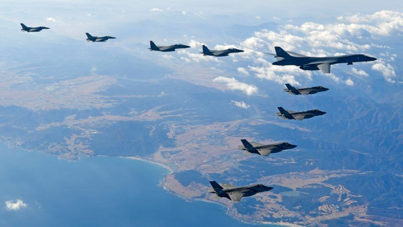 """This handout taken and released by the South Korean Defence Ministry in Seoul on December 6, 2017 shows a US Air Force B-1B Lancer bomber (R top), two US F-35A (middle) and two US F-35B (bottom) stealth jets flying over South Korea with South Korea's two F-16 (L) and two F-15K (C top) fighter jets during a joint military drill. The five-day Vigilant Ace drill -- involving some 230 aircraft including F-22 Raptor stealth jet fighters -- began on December 4, five days after North Korea test-fired an intercontinental ballistic missile believed to be capable of hitting the US mainland in a new challenge to US President Donald Trump.   / AFP PHOTO / South Korean Defence Ministry / HANDOUT / RESTRICTED TO EDITORIAL USE - MANDATORY CREDIT """"AFP PHOTO / SOUTH KOREAN DEFENCE MINISTRY"""" - NO MARKETING NO ADVERTISING CAMPAIGNS - DISTRIBUTED AS A SERVICE TO CLIENTS"""