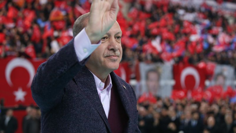 """This handout picture taken and released on December 10, 2017, by the Turkish Presidential Press Office shows Turkish President Recep Tayyip Erdogan waving at supporters during a rally in Sivas. Turkish President Recep Tayyip Erdogan described Israel as a """"terrorist state"""" on December 10, 2017, and vowed to use """"all means to fight"""" against the US recognition of Jerusalem as the country's capital. """"Palestine is an innocent victim... As for Israel, it is a terrorist state, yes, terrorist!"""" Erdogan said in a speech in the central city of Sivas. """"We will not abandon Jerusalem to the mercy of a state that kills children."""" / AFP PHOTO / TURKISH PRESIDENTIAL PRESS SERVICE / YASIN BULBUL / RESTRICTED TO EDITORIAL USE - MANDATORY CREDIT """"AFP PHOTO / TURKISH PRESIDENTIAL PRESS OFFICE/YASIN BULBUL"""" - NO MARKETING NO ADVERTISING CAMPAIGNS - DISTRIBUTED AS A SERVICE TO CLIENTS   / """"The erroneous mention[s] appearing in the metadata of this photo by YASIN BULBUL has been modified in AFP systems in the following manner: [TURKISH PRESIDENTIAL PRESS OFFICE] as source instead of [AFP]. Please immediately remove the erroneous mention[s] from all your online services and delete it (them) from your servers. If you have been authorized by AFP to distribute it (them) to third parties, please ensure that the same actions are carried out by them. Failure to promptly comply with these instructions will entail liability on your part for any continued or post notification usage. Therefore we thank you very much for all your attention and prompt action. We are sorry for the inconvenience this notification may cause and remain at your disposal for any further information you may require."""""""