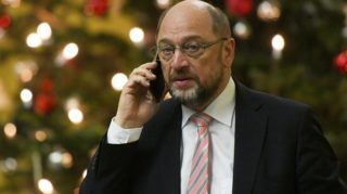 The leader of the Social Democratic Party (SPD), Martin Schulz speaks on the phone as he arrives at the Jakob Kaisers haus at the German parliament for a meeting on December 13, 2017 in Berlin. Chancellor Angela Merkel meets Social Democrat leaders on December 13, 2017, in a new bid to end a political stalemate nearly three months after elections left Germany in limbo. The meeting at 7 pm (1800 GMT), which also gathers the leader of Merkel's Bavarian allies, comes after SPD chief Martin Schulz obtained the blessing from his party last week to hold open-ended talks with the chancellor. / AFP PHOTO / dpa / Maurizio Gambarini / Germany OUT