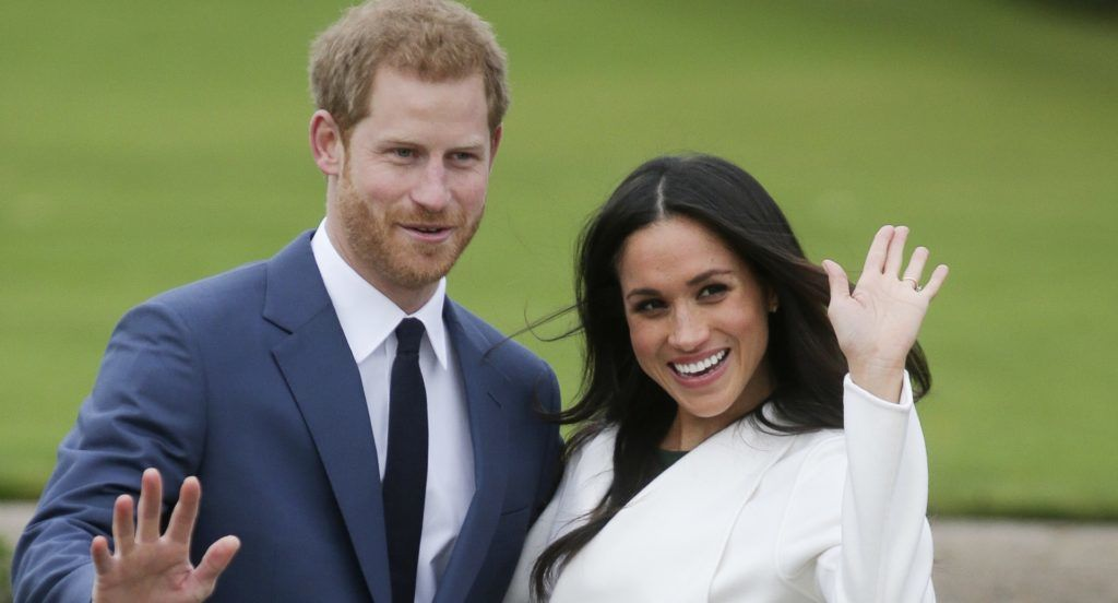 (FILES) This file photo taken on November 27, 2017 shows Britain's Prince Harry and his fiancée US actress Meghan Markle posing for a photograph in the Sunken Garden at Kensington Palace in west London following the announcement of their engagement. Meghan Markle is to become the first fiancee invited to spend Christmas with the British royal family -- a move hailed December 14, 2017, as a sea change in the monarchy's traditionalist attitude. / AFP PHOTO / Daniel LEAL-OLIVAS