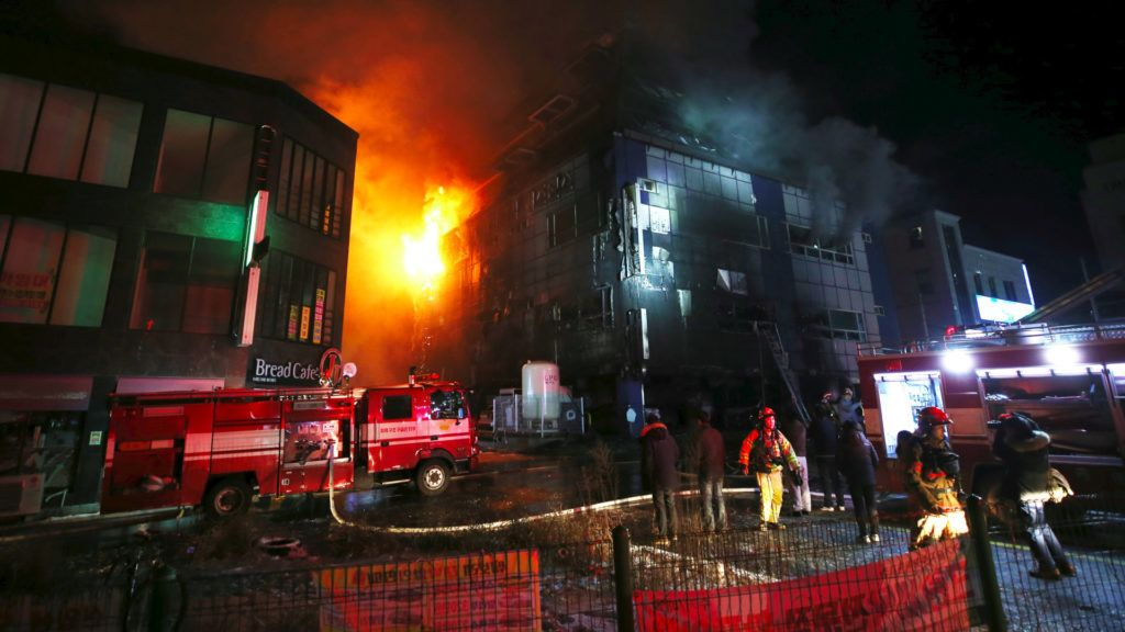 Flames and smoke billow from an eight-storey building after a fire broke out in Jecheon, 120 kilometers southeast of Seoul, on December 21, 2017. Sixteen people died and more than 10 others were injured in a fire that engulfed a commercial building in Jecheon on December 21, Yonhap reported.  / AFP PHOTO / YONHAP / - /  - South Korea OUT / REPUBLIC OF KOREA OUT  NO ARCHIVES  RESTRICTED TO SUBSCRIPTION USE