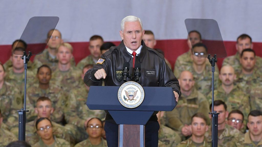 US Vice President Mike Pence speaks to troops in a hangar at Bagram Air Field in Afghanistan on December 21, 2017. POOL / AFP PHOTO / POOL / Mandel NGAN