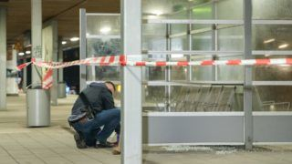 A police defuser inspects the crime scene at the railway station Veddel in Hamburg, Germany, 17 December 2017. The evening saw an explosion at the railway station - no one was injured. Photo: Daniel Bockwoldt/dpa