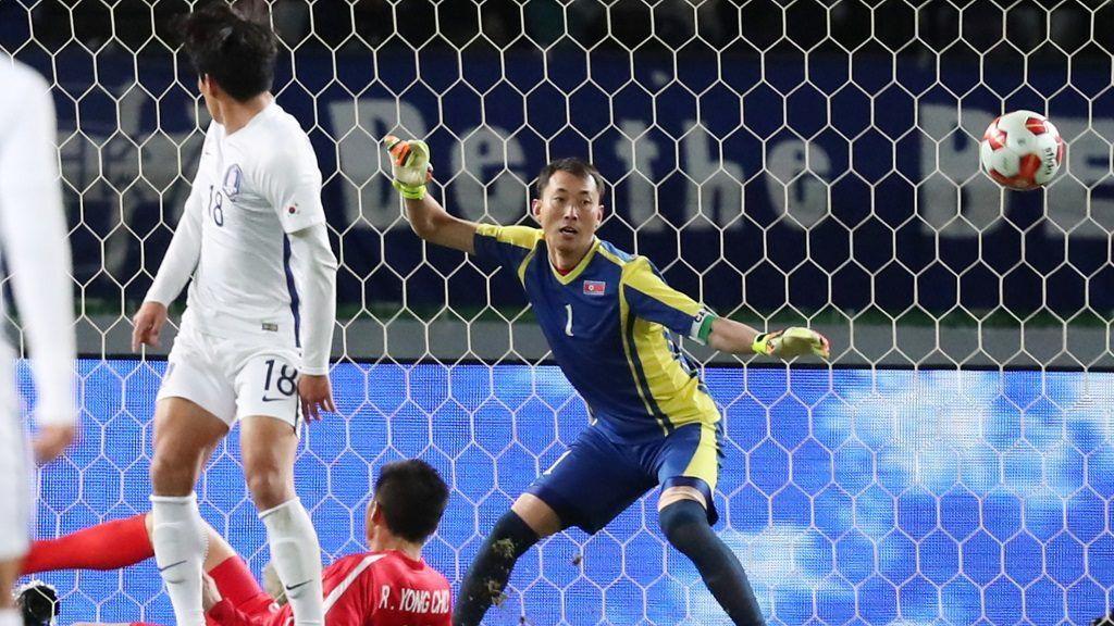 North Korea defender Ri Yong-Chol (lower L) scores an own goal during the second half of the EAFF E-1 Football Championship Final match against South Korea at Ajinomoto Stadium in Chofu City, Tokyo on Dec.12, 2017. South Korea won by 1-0.  ( The Yomiuri Shimbun )