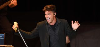 """LOS ANGELES, CA - JUNE 06:  Singer Ricky Martin performs onstage during the """"Hillary Clinton: She's With Us"""" concert at The Greek Theatre on June 6, 2016 in Los Angeles, California.  (Photo by Kevin Winter/Getty Images)"""