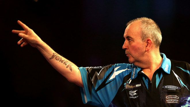 LONDON, ENGLAND - DECEMBER 18:  Phil Taylor of England throws during his first round match against David Platt of England  during Day Four of the 2017 William Hill PDC World Darts Championships  at Alexandra Palace on December 18, 2016 in London, England.  (Photo by Alex Pantling/Getty Images)