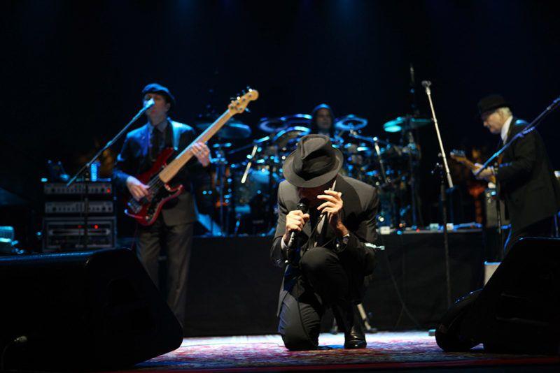 COACHELLA, CA - APRIL 17: Musician Leonard Cohen  performs on day 1 of Coachella Valley Music & Arts Festival 2009  at Empire Polo Field on April 17, 2009 in Coachella, California. (Photo by Barry Brecheisen/WireImage)