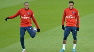 PARIS, FRANCE - OCTOBER 25:  Kylian Mbappe (L) and Neymar Jr of Paris Saint-Germain warm up during a Paris Saint-Germain practice session at Centre Ooredoo on October 25, 2017 in Paris, France.  (Photo by Aurelien Meunier/Getty Images)