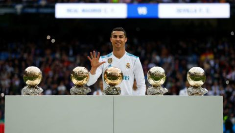 MADRID, SPAIN - DECEMBER 09: Cristiano Ronaldo of Real Madrid CF poses with his five Golden Ball (Ballon d'Or) trophies   prior to start the La Liga match between Real Madrid CF and Sevilla FC at Estadio Santiago Bernabeu on December 9, 2017 in Madrid, Spain . (Photo by Gonzalo Arroyo Moreno/Getty Images)