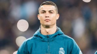 MADRID, SPAIN - DECEMBER 06: Cristiano Ronaldo of Real Madrid getting into the field during the Europe Champions League 2017-18 match between Real Madrid and Borussia Dortmund at Santiago Bernabeu Stadium on 06 December 2017 in Madrid Spain. Photo by Diego Gonzalez / Power Sport Images