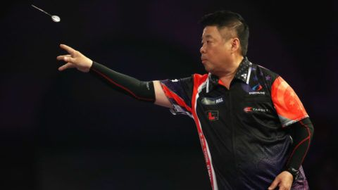 LONDON, ENGLAND - DECEMBER 18: Paul Lim of Singapore in action during his preliminary round match against Kai Fan Leung of China on day five of the 2018 William Hill PDC World Darts Championships at Alexandra Palace on December 18, 2017 in London, England.  (Photo by Linnea Rheborg/Getty Images)
