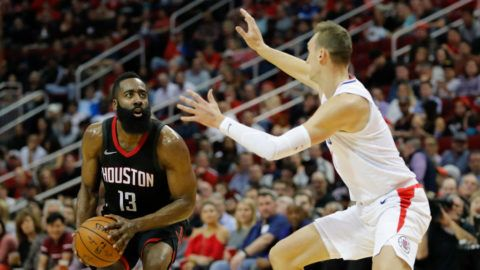 HOUSTON, TX - DECEMBER 22:  James Harden #13 of the Houston Rockets pulls up for a three point shot defended by Sam Dekker #7 of the LA Clippers in the first half at Toyota Center on December 22, 2017 in Houston, Texas.  NOTE TO USER: User expressly acknowledges and agrees that, by downloading and or using this Photograph, user is consenting to the terms and conditions of the Getty Images License Agreement.  (Photo by Tim Warner/Getty Images)