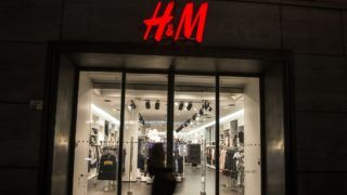 People walk past a store of the Swedish fashion chain H&M (Hennes & Mauritz) in Berlin, Germany, 1 February 2017. The company wants to concentrate more on the online business and plans on cutting down on the number of stores. Photo: Paul Zinken/dpa