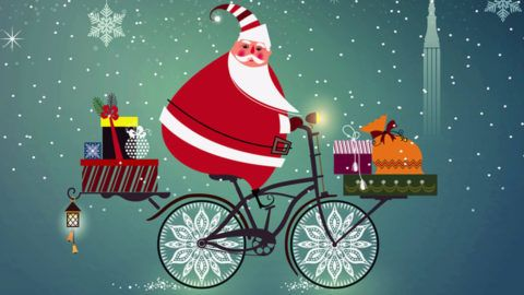 Cute Santa Claus on a bicycle.