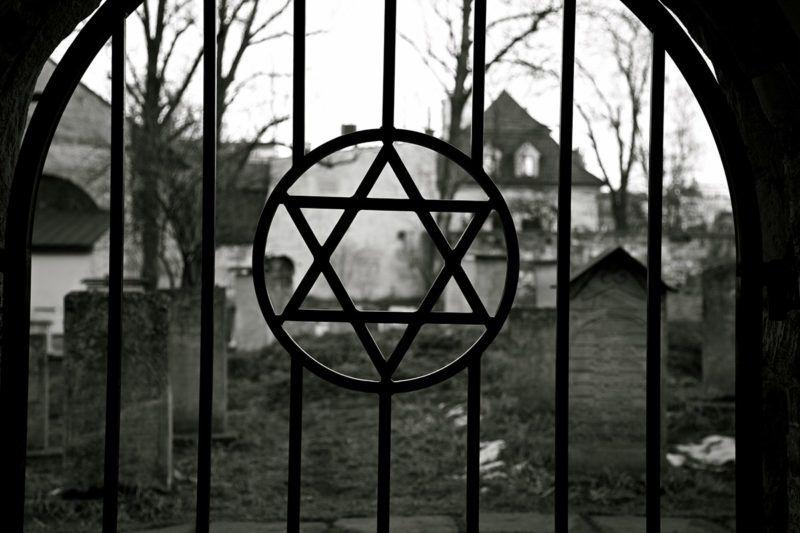 Judaism symbol. Jewish Star of David. Jude Cemetery in Cracow Ghetto. Kazimierz district. Poland. Auschwitz and Holocaust metaphor. Black and white.