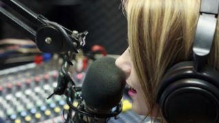 Beautiful Woman Working As Radio DJ Live In Studio