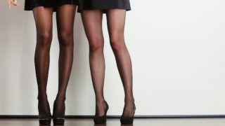 Part of body people concept. Beautiful women long legs. Black elegant skirt and dark high heels.