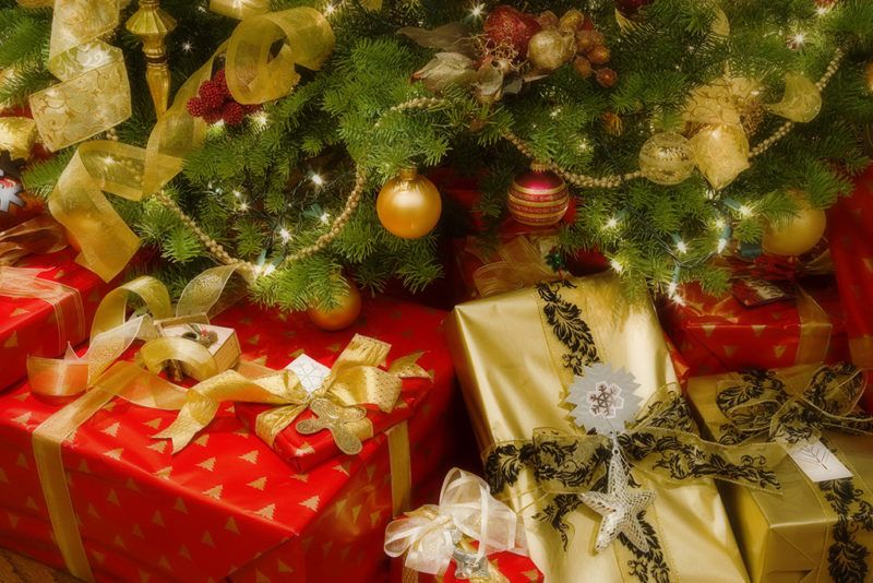 Close-up of Christmas presents in front of a Christmas tree