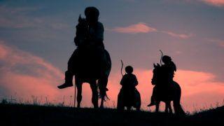 Horsemen riding on the sunset