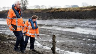 2017-01-03 14:39:01 Inspectors of Rijkswaterstaat control the area of the Maas-Waal canal in Mook, The Netherlands, 03 January 2017. The low water levels on the Maas river are caused by the damages of the weir at the Thompson Bridge after the inland vessel Maria Valentine has crushed into the Bridge due to reduced visibility by dense fog on Thursday evening 29 December. As a result the river Maas running between the weir in Sambeek and Grave deflates. ANP PIROSCHKA VAN DE WOUW