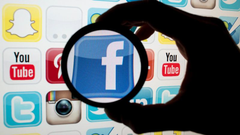 ILLUSTRATION - A staged photograph taken in Munich, Germany, on the 11 December 2016 shows the Facebook logo seen through a magnifying glass alongside the logos of other apps. Photo: Tobias Hase/dpa   usage worldwide