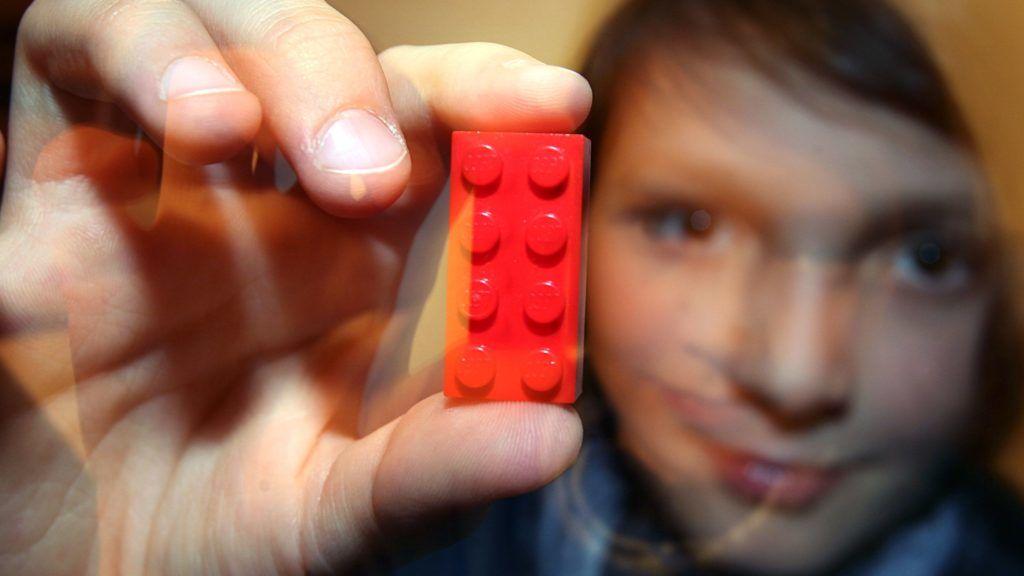 A little boy presents a red Lego brick in Kaufbeuren, Germany, Monday 13 November 2006. Photo: Karl-Josef Hildenbrand