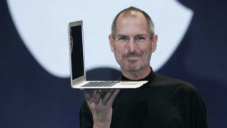 Apple CEO and co-founder Steve Jobs holds up the new Mac Book Air after he delivered the keynote speech to kick off the 2008 Macworld Conference and Expo 15 January 2008 in San Francisco. Jobs introduced the wireless Time Capsule backup appliance, iTV 2 and the new ultra thin laptop MacBook Air.                  AFP PHOTO/David Paul Morris/Getty Images                FOR NEWSPAPERS, INTERNET, TELCOS AND TELEVISION USE ONLY