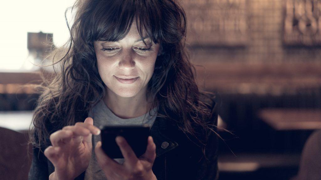 Woman using smartphone.  Paris, France   GARO/PHANIE