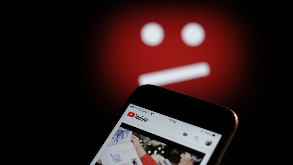 The YouTube video sharing application is seen on an iPhone with the symbol for unavailable content in the background in this photo illustration on December 1, 2017. (Photo by Jaap Arriens/NurPhoto)