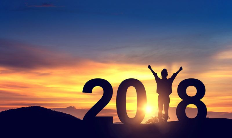 Silhouette young woman enjoying on the hill and 2018 years while celebrating new year