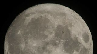 The International Space Station, with a crew of six onboard, is seen in silhouette as it transits the Moon at roughly five miles per second, Saturday, Dec. 2, 2017, in Manchester Township, York County, Pennsylvania. Onboard are: NASA astronauts Joe Acaba, Mark Vande Hei, and Randy Bresnik; Russian cosmonauts Alexander Misurkin and Sergey Ryanzansky; and ESA astronaut Paolo Nespoli.  Photo Credit: (NASA/Joel Kowsky)