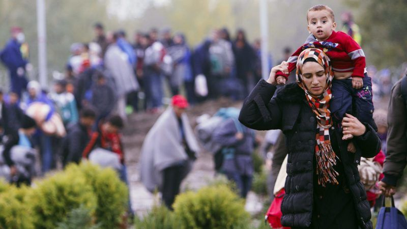 Migrants make their way through the countryside after they crossed the Hungarian-Croatian border near the village of Zakany in Hungary to continue their trip to north on October 16, 2015. Hungary said it will shut its border with Croatia at midnight, closing a major entry point for migrants bound for northern Europe, weeks after a similar move on its Serbian frontier triggered clashes with refugees.    AFP PHOTO / HANNA SONIA / AFP PHOTO / HANNA SONIA