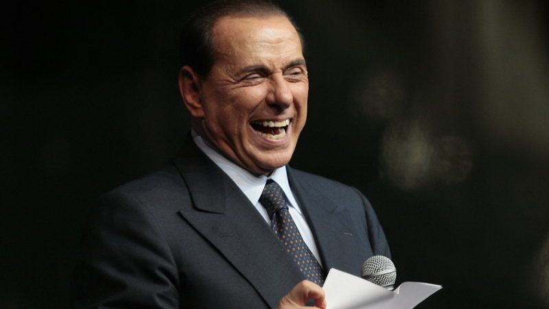 "Italian Prime Minister Silvio Berlusconi delivers a speech during the ""Festa della Liberta"" (The freedom festival) organised by his party ""Il popolo della Liberta"" (the people of freedom) on October 5, 2008, in Milan. AFP PHOTO / EMILIO ANDREOLI / AFP PHOTO / Emilio Andreoli"