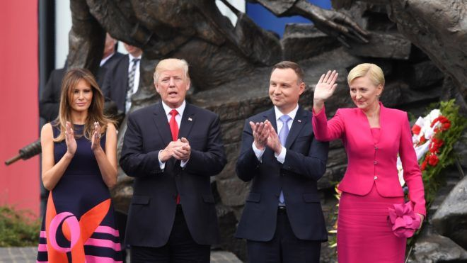 US President Donald Trump (2ndL), his wife Melania Trump (L) and the Polish President Andrzej Duda and his wife Agata Kornhauser-Duda (R) stand in front of the Warsaw Uprising Monument on Krasinski Square after Donald Trump gave a speech during the Three Seas Initiative Summit in Warsaw, Poland, July 6, 2017. / AFP PHOTO / JANEK SKARZYNSKI
