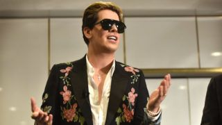 """Right-wing British provocateur Milo Yiannopoulos answers questions during a speech at Parliament House in Canberra on December 5, 2017. Yiannopoulos blasted those who do not agree with him as """"petulant babies"""" after violent protests in Melbourne. The polarising former Breitbart editor is touring with his """"The Troll Academy"""" speaking show. Hundreds of protestors clashed with police and supporters of Yiannopoulos outside a supposedly secret venue in Melbourne on December 4.  / AFP PHOTO / MARK GRAHAM"""