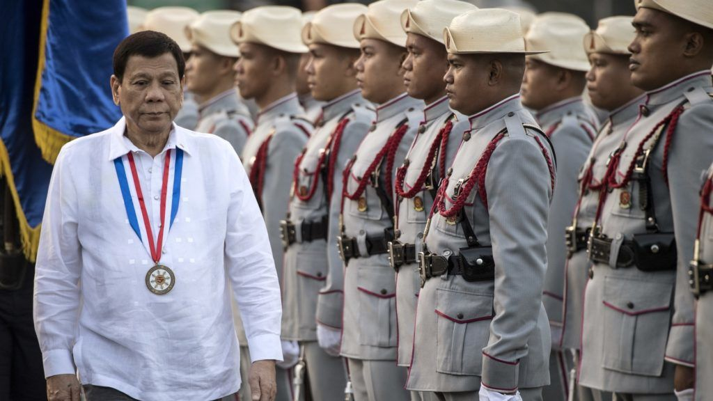 Philippines' President Rodrigo Duterte inspects the honour guards during the commemoration of the 121st death anniversary of the country's national hero Jose Rizal at the Rizal Monument in Manila on December 30, 2017.  Rizal was sentenced to die by a firing squad by the Spanish after he was accused of leading a revolution against Spain. / AFP PHOTO / Noel CELIS