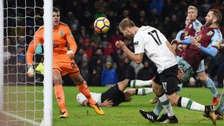 Liverpool's Estonian defender Ragnar Klavan (C) stoops to head home their second goal during the English Premier League football match between Burnley and Liverpool at Turf Moor in Burnley, north west England on January 1, 2018. Liverpool won the game 2-1. / AFP PHOTO / Oli SCARFF / RESTRICTED TO EDITORIAL USE. No use with unauthorized audio, video, data, fixture lists, club/league logos or 'live' services. Online in-match use limited to 75 images, no video emulation. No use in betting, games or single club/league/player publications.  /
