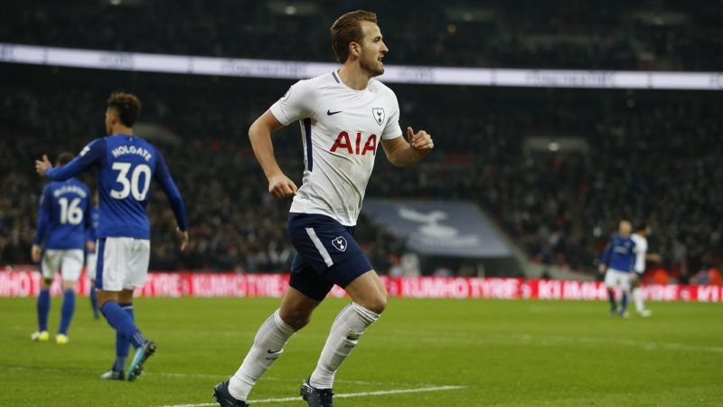 Tottenham Hotspur's English striker Harry Kane celebrates scoring the team's first goal during the English Premier League football match between Tottenham Hotspur and Everton at Wembley Stadium in London, on January 13, 2018. / AFP PHOTO / Ian KINGTON / RESTRICTED TO EDITORIAL USE. No use with unauthorized audio, video, data, fixture lists, club/league logos or 'live' services. Online in-match use limited to 75 images, no video emulation. No use in betting, games or single club/league/player publications.  /