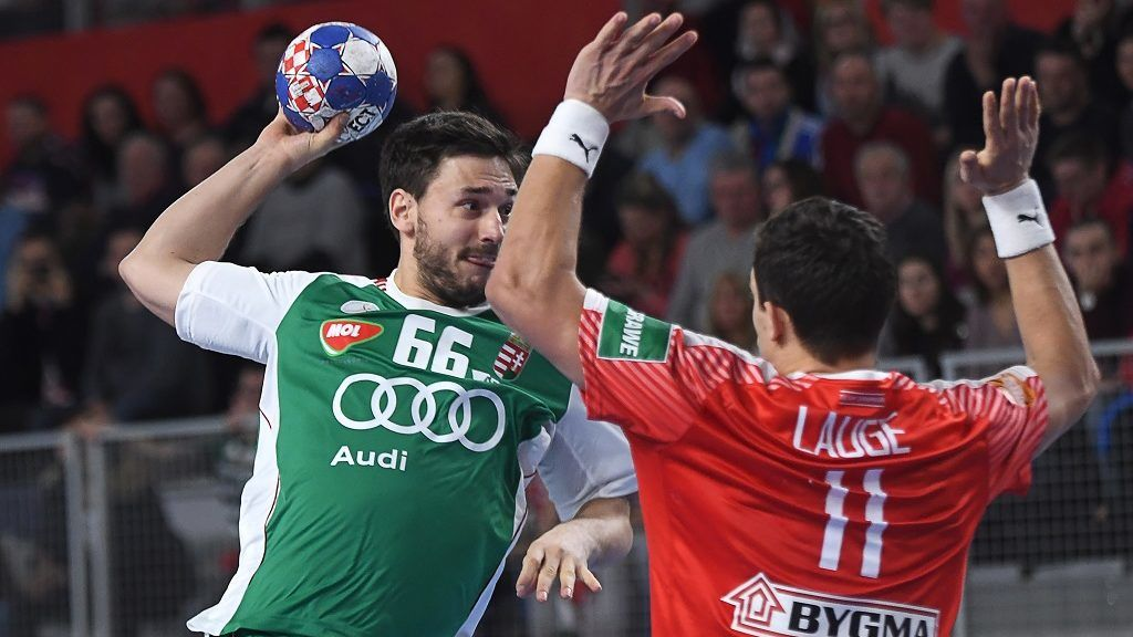 Hungary's Mate Lekai (L) scores a goal against Denmark's Rasmus Lauge Schmidt (R) during their match in the 13th edition of the EHF European Men's Handball Championship,  Group D match, Hungary versus Denmark at the Varazdin Arena in Varazdin on January 13, 2018. / AFP PHOTO / ATTILA KISBENEDEK