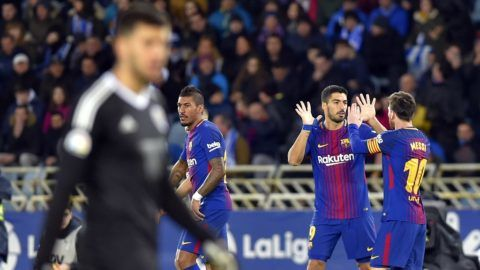 Barcelona's Uruguayan forward Luis Suarez (2R) celebrates a goal with Barcelona's Argentinian forward Lionel Messi during the Spanish league football match between Real Sociedad  and FC Barcelona at the Anoeta stadium in San Sebastian on January 14, 2018. / AFP PHOTO / ANDER GILLENEA