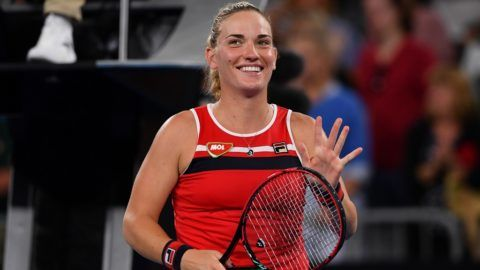 Hungary's Timea Babos celebrates her victory against Coco Vandeweghe of the US during their women's singles first round match on day one of the Australian Open tennis tournament in Melbourne on January 15, 2018. / AFP PHOTO / SAEED KHAN / -- IMAGE RESTRICTED TO EDITORIAL USE - STRICTLY NO COMMERCIAL USE --