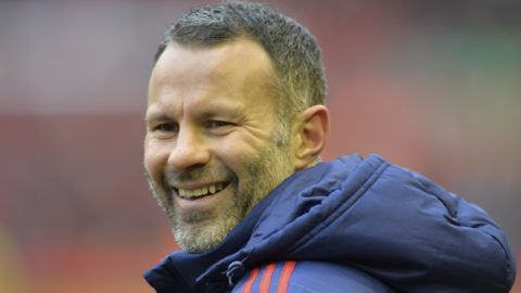 (FILES) This file photo taken on January 17, 2016 shows Manchester United's Welsh assistant manager Ryan Giggs smiling during a warm up before the English Premier League football match between Liverpool and Manchester United at Anfield in Liverpool. Manchester United great Ryan Giggs is set to be named Wales boss on January 15, 2018 -- his first permanent job as a manager. / AFP PHOTO / PAUL ELLIS