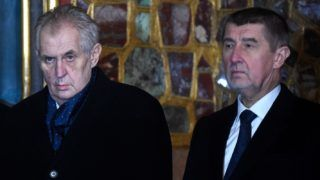 Czech Prime Minister Andrej Babis (R) and Czech President Milos Zeman (L) attend the ceremony presenting the Crown of Saint Wenceslas of Bohemia prior the opening of the 'Czech Jewels' exhibition on January 15, 2018, at the Prague Castle in the Czech capital. The crown, named after the Duke and Patron Saint Wenceslas I of the Premyslids dynasty of Bohemia, has an unusual design, with vertical fleurs-de-lis standing at the front, back and sides. Made of gold and precious stones for King Charles IV in 1347, it weights 2.475kg. Since 1867 it has been stored in the St. Vitus Cathedral of the Prague Castle. The jewels have always played an important role as a symbol of Bohemian statehood. / AFP PHOTO / Michal Cizek