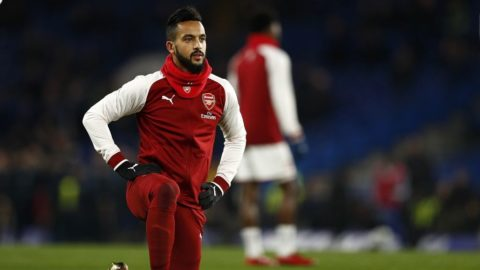(FILES) This file photo taken on January 10, 2018 shows Arsenal's English midfielder Theo Walcott warming up ahead of the English League Cup semi-final first leg football match between Chelsea and Arsenal at Stamford Bridge in London. Everton signed England winger Theo Walcott from Arsenal in a deal worth a reported £25 million ($34 million, 28.3 million euros) on January 17, 2018. / AFP PHOTO / Adrian DENNIS / RESTRICTED TO EDITORIAL USE. No use with unauthorized audio, video, data, fixture lists, club/league logos or 'live' services. Online in-match use limited to 75 images, no video emulation. No use in betting, games or single club/league/player publications.  /