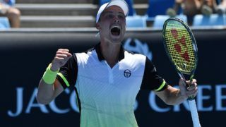 Hungary's Marton Fucsovics celebrates beating Sam Querrey of the US in their men's singles second round match on day four of the Australian Open tennis tournament in Melbourne on January 18, 2018. / AFP PHOTO / Greg Wood / -- IMAGE RESTRICTED TO EDITORIAL USE - STRICTLY NO COMMERCIAL USE --