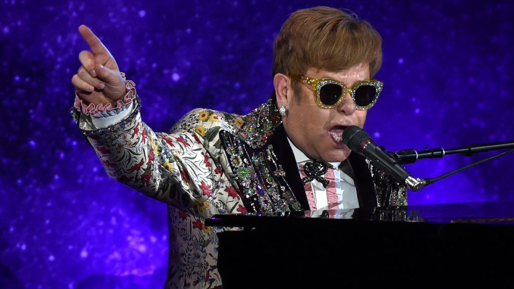 """Sir Elton John performs two songs before holding a press conference in New York on January 24, 2018. Pop legend Elton John on Wednesday announced a final tour, saying he intends to stop traveling to spend more time with his family. The 70-year-old British entertainer, revealing his plans at a gala New York event, said he planned to """"go out with a bang"""" with a global tour that may last several years.  / AFP PHOTO / TIMOTHY A. CLARY"""
