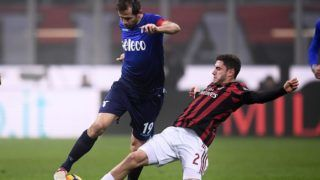 Lazio's midfielder Senad Lulic of Bosnia (C) fights for the ball with AC Milan's defender Davide Calabria from Italy (R) during the Italian Serie A football match AC Milan Vs Lazio on January 28, 2018 at the 'Giuseppe Meazza' Stadium in Milan. / AFP PHOTO / MARCO BERTORELLO