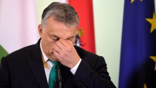 """Hungarian Prime Minister Viktor Orban address a press conference following a meeting at the Chancellery in Vienna on January 30, 2018. (Photo credit should read """"ROLAND SCHLAGER/APA-PictureDesk via AFP"""")"""